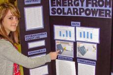 student presenting project at science fair